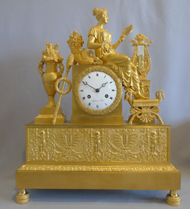 French Empire ormolu mantel clock depicting vanity?.