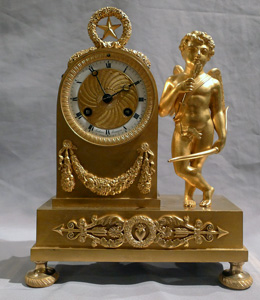 Antique French Empire miniature ormolu clock of Cupid signed by Ledure and Thomas