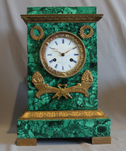 Malachite clock with rare movement by Rodier Hr a Paris.
