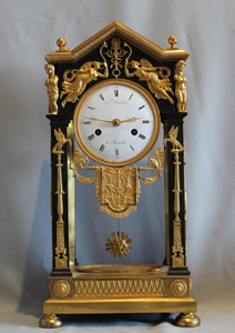Antique French Empire ormolu and patinated bronze portico clock N. Jennart, Brussels.