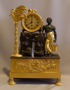 French Empire ormolu and bronze automaton Blackamoor and fountain mantle clock
