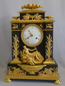 Antique French Empire clock in ormolu and patinated bronze celebrating  Poseidon.