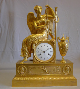 Antique French Empire ormolu mantel clock of winged goddess..