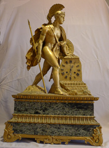 Antique French marble and ormolu mantel clock of a Greek warrior.