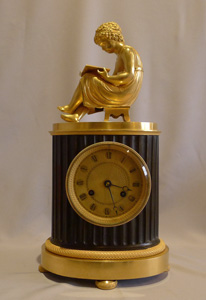 Antique French Empire library clock of a child reading..