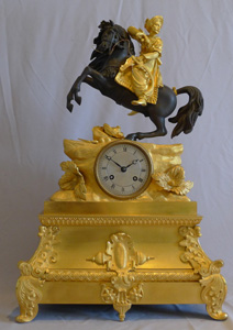 Antique French Greek Revolution or Hellenistic mantel clock of Turk on horseback.