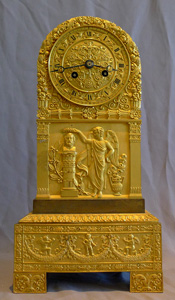 Antique French Charles X mantel clock in patinated bronze and ormolu of Borne ( milestone) form.