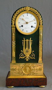 French Empire antique clock, ormolu, patinated bronze and marble signed by both Ravrio and Mesnil.