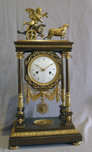Antique French Empire Portico clock by Leroy in patinated bronze and ormolu..