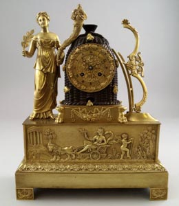 Antique French Charles X ormolu mantle clock with beehive.