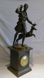 Antique French Charles X period patinated bronze mantel clock with bronze of Diana.