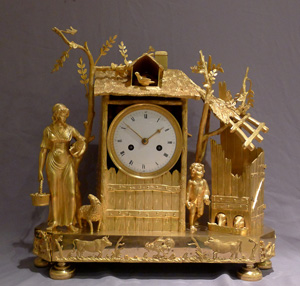 Antique French Empire ormolu mantel clock of the Arcadian Genre.