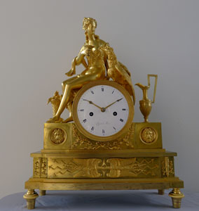 Antique French Empire ormolu clock depicting the goddess Juno or Hera.