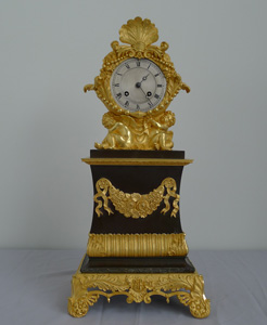 Antique Charles X patinated bronze and ormolu clock signed Pinedde a Poitiers.