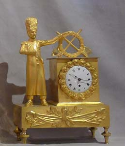 Miniature French Empire ormolu mantel clock of soldier.