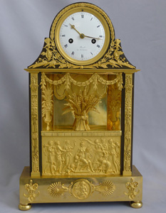 Antique French Empire mantel clock in ormolu and patinated bronze signed  Revel Rue De Richelieu