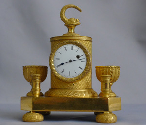 Antique French Empire clock in ormolu set in ecrier
