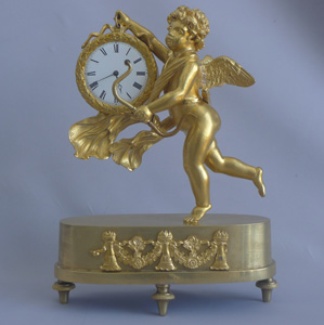 Antique French Empire miniature ormolu mantel clock of Cupid carrying off Time
