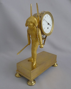 French Empire antique Ormolu clock of Harlequin as a street porter carrying time