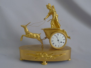 Antique French Empire Miniature ormolu mantel clock of Diane in a chariot