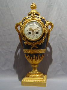 Antique French Napoleon III enamel and ormolu urn clock signed in the bronze Eug. Hazard.