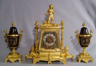 Antique French porcelain and ormolu Egyptian revival clock set signed in the bronze Masselette