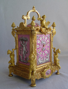 Antique French clock in pink porcelain and ormolu by Levy