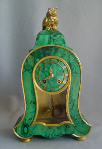 Antique Russian mantel clock veneered in Siberian malachite.