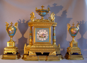 French antique clock set in ormolu and bleu celeste porcelain on original stands.
