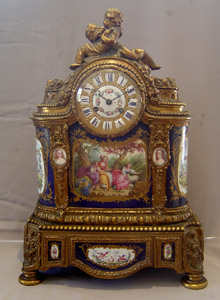 Antique French porcelain and ormolu mantle clock with painting after Boucher.