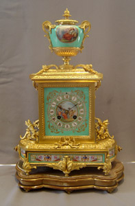 Antique French turquoise porcelain and ormolu mantel clock.