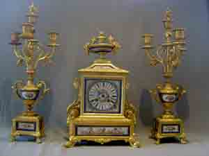 French antique clock set, clock plus candelabra in ormolu and sky blue porcelain.