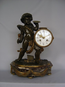 Antique clock French patinated and gilt bronze with griotte marble of Cupid playing drum and cymbal.
