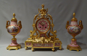 Antique French pink porcelain and gilt bronze clock garniture.