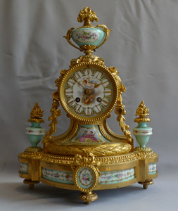 French Antique porcelain and ormolu clock in turquoise porcelain.