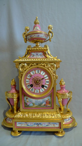 French antique mantel clock in ormolu and pink porcelain.