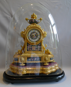 Antique mantel clock in ormolu and porcelain clock under dome.Achille Brocot