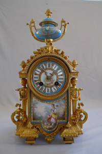 Antique French porcelain and ormolu mantel clock.