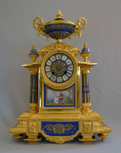 French mantel clock in porcelain and ormolu.