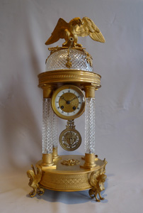Antique crystal and bronze mantel clock with Napoleonic trophies