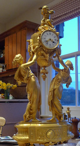 Antique French manel clock in ormolu of large size.