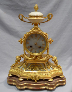 French antique mantel clock in ormolu and opaque alabaster.