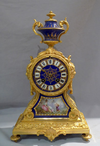 Antique French ormolu and blue jewelled porcelain mantel clock.