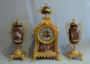 Antique French clock in ormolu with porcelain painted  Dutch style interiors.