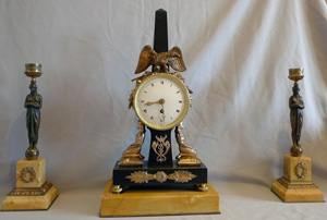 Antique Egyptian style clock set in patinated bronze and Sienna marble.
