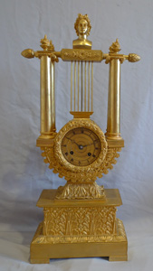 Antique French Napoleon III ormolu lyre clock.