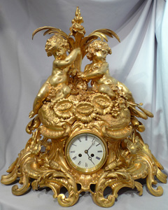 Antique French Victorian or Napoleon III large ormolu mantel clock with cherubs.