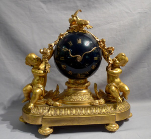 Antique French mantel clock in ormolu and blue enameled globe.