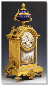 Antique French mantel clock in porcelain and ormolu.