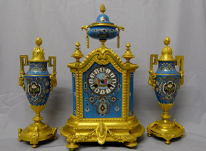 Antique porcelain and ormolu mantel clock set in blue with geometric moorish patterns.